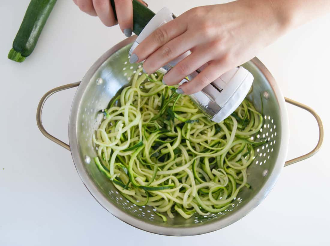 Spring Pesto Zoodles -- This light nutrient-packed zucchini noodles recipe is an amazing low carb dinner option. The pesto stars Spring produce and it makes for a delicious plant based meal. | mindfulavocado