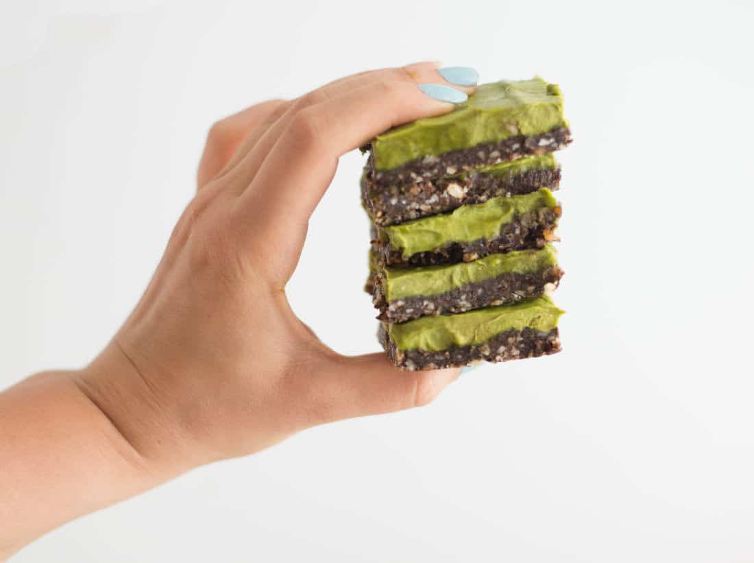 Chocolate Avocado Bars -- These creamy, chocolatey avocado bars are a healthy dessert without sacrificing flavor. Loaded with nutritious ingredients such as avocado, raw cacao, dates, and cashews.This dessert bar recipe is so delicious, you will not believe they are raw vegan, paleo, AND gluten free. | mindfulavocado