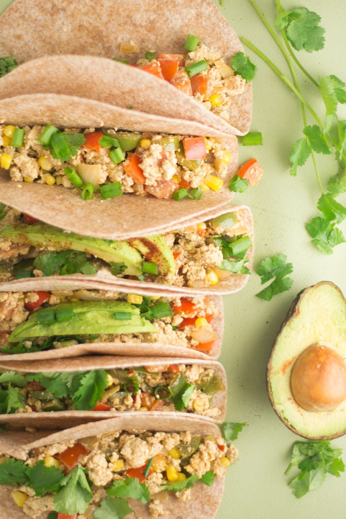 Tofu Scramble Tacos -- These tofu scramble tacos are so easy to make and are packed with veggies and protein. Upgrade you breakfast routine or try these mexican inspired vegan tacos for lunch or dinner. They are delicious any time of the day. | mindfulavocado