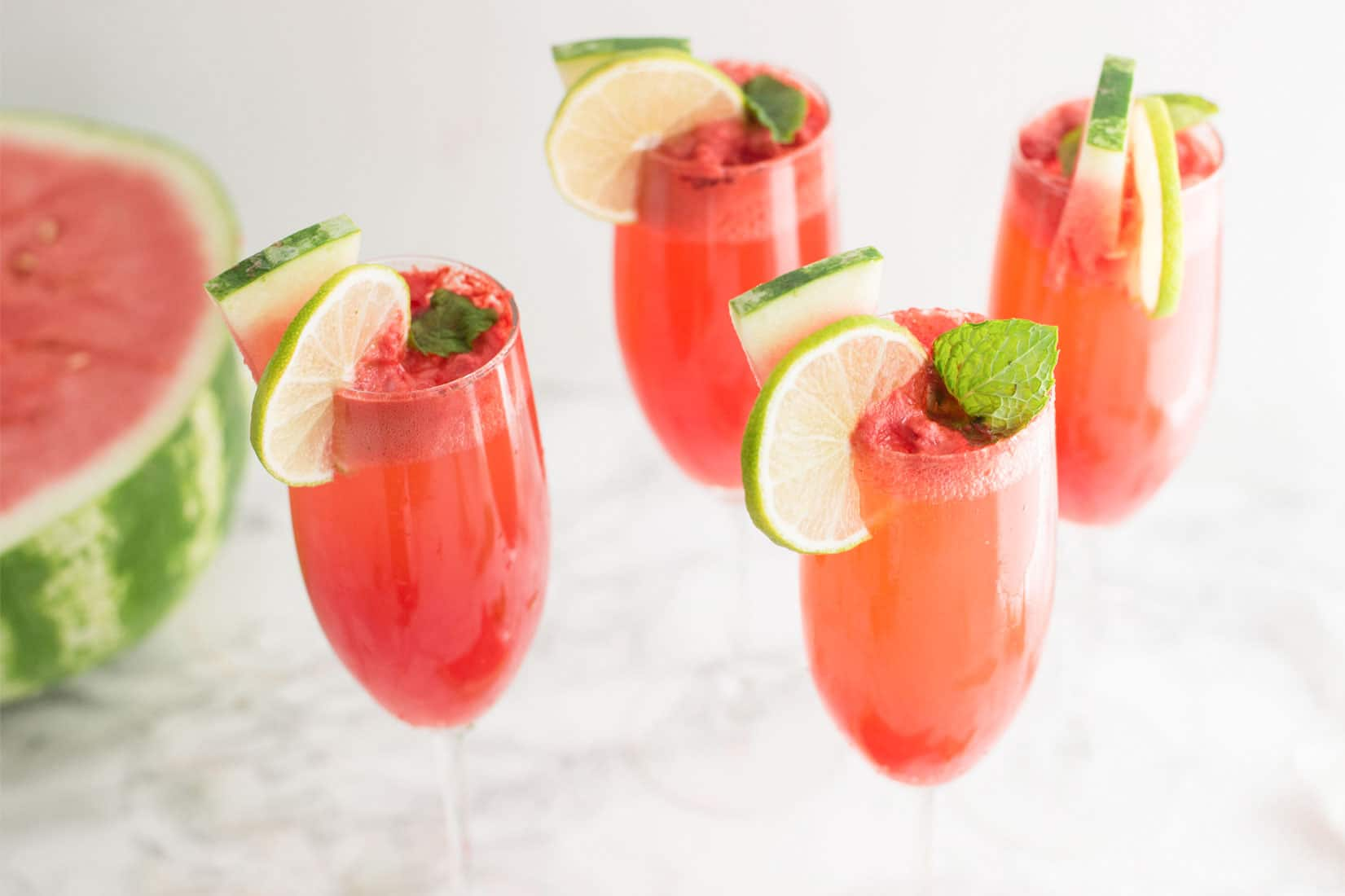 Watermelon Mint Mimosas -- This delicious and easy mimosa recipe only calls for watermelon, mint, lime, and champagne of course. You have to try this healthy drink! - mindfulavocado