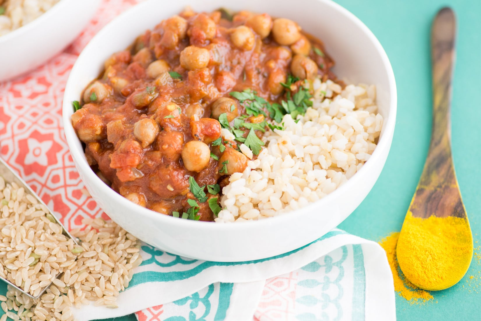 Slow Cooker Chana Masala -- Easy chana masala recipe made with healthy ingredients. Just throw everything into your crockpot and you will have a comforting flavorful meal waiting for you. Top this vegetarian Indian recipe over a bed of rice for a wholesome plant based dinner. | mindfulavocado