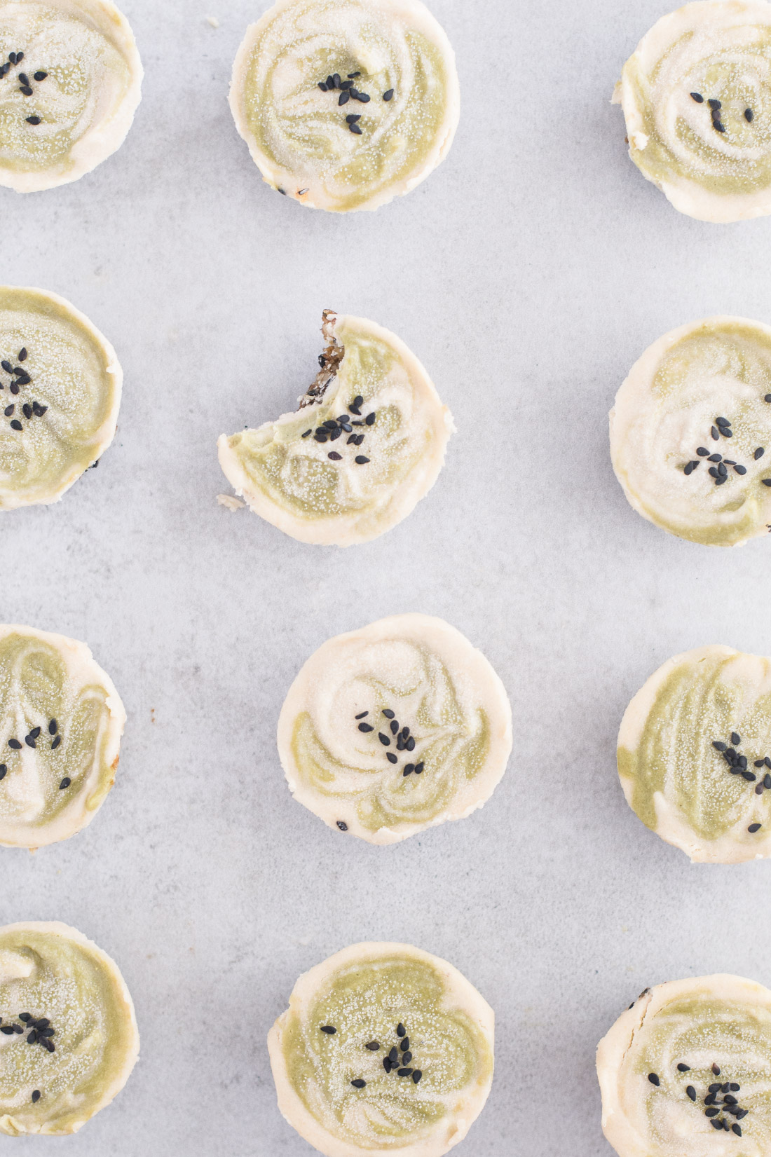Black Sesame Matcha Raw Cheesecake Bites -- Raw vegan cheesecake is the perfect bite sized treat that taste delicious and are GOOD for you. Cashews, dates, sesame seeds, and real matcha powder are some of the star ingredients in this healthy dessert recipe. | mindfulavocado