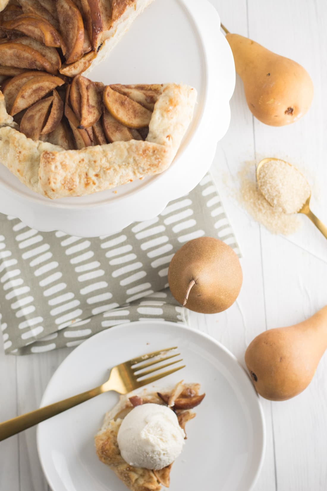 Vegan Pear Galette -- This vegan galette is made up of a perfectly flakey pie crust and piled high with cinnamon ginger pear slices. Baked to perfection, you won't believe how simple this dessert recipe is to make | mindfulavocado