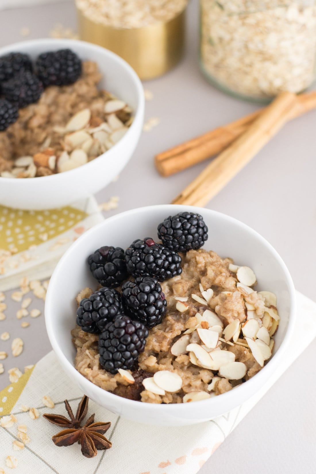 Chai Spice Slow Cooker Oatmeal -- This crockpot oatmeal is so simple to make and beyond flavorful. Oats, coconut milk, and chai spice whisked together and sweetened with maple syrup and brown sugar. Healthy breakfast just got a lot more comforting. | mindfulavocado