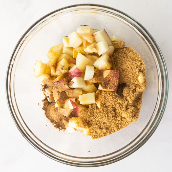 mixture for baked cinnamon apples in mixing bowl