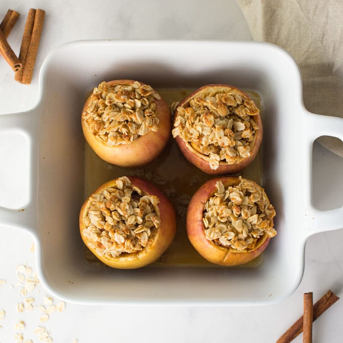 baked apples with oat topping in baking dish