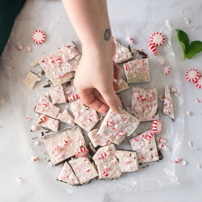 hand reaching for piece of peppermint bark