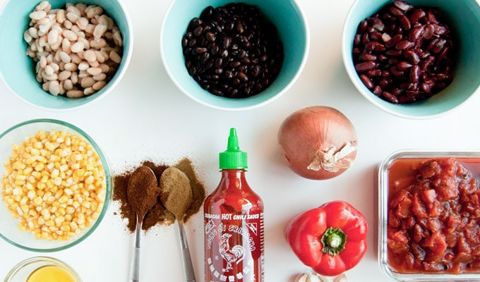 ingredients for vegan chili on white background