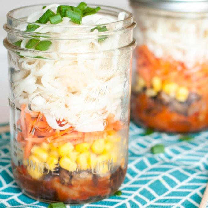 mason jar ramen with carrots, corn, mushrooms, noodles, and green onions