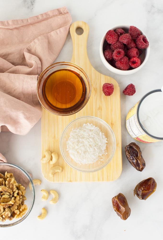 ingredients for raw mini vegan cheesecakes with raspberries