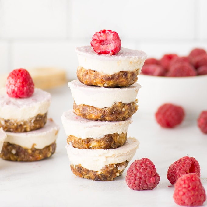 stack of mini raw vegan cheesecakes with raspberries