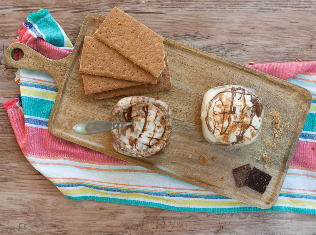"""Aquafaba Smores Parfaits -- Calling all s'more fans! This aquafaba smores parfait is the perfect nostalgic campfire treat that got a healthy upgrade. A graham cracker crust layer topped with chocolate mousse, and a big layer of aqafaba """"whipped cream"""". Using chickpea brine aka aquafaba instead of egg whites, makes this vegan dessert a great plant based dessert recipe. 