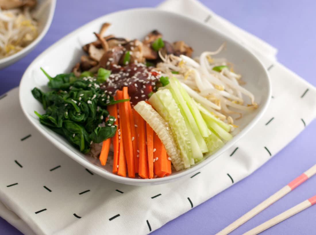 Vegan Bibimbap Bowls -- This vegan bibimbap bowl is a healthy option for lunch or dinner! Packed with brown rice, vegetables, and a spicy Korean sauce. | mindfulavocado