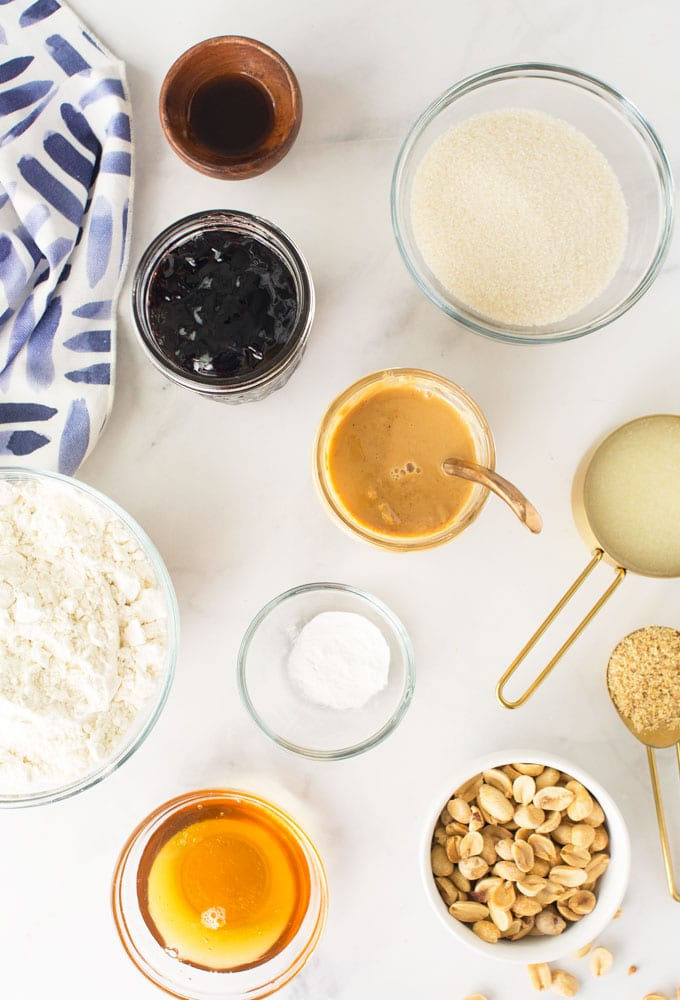 ingredients for peanut butter and jelly bars on marble background