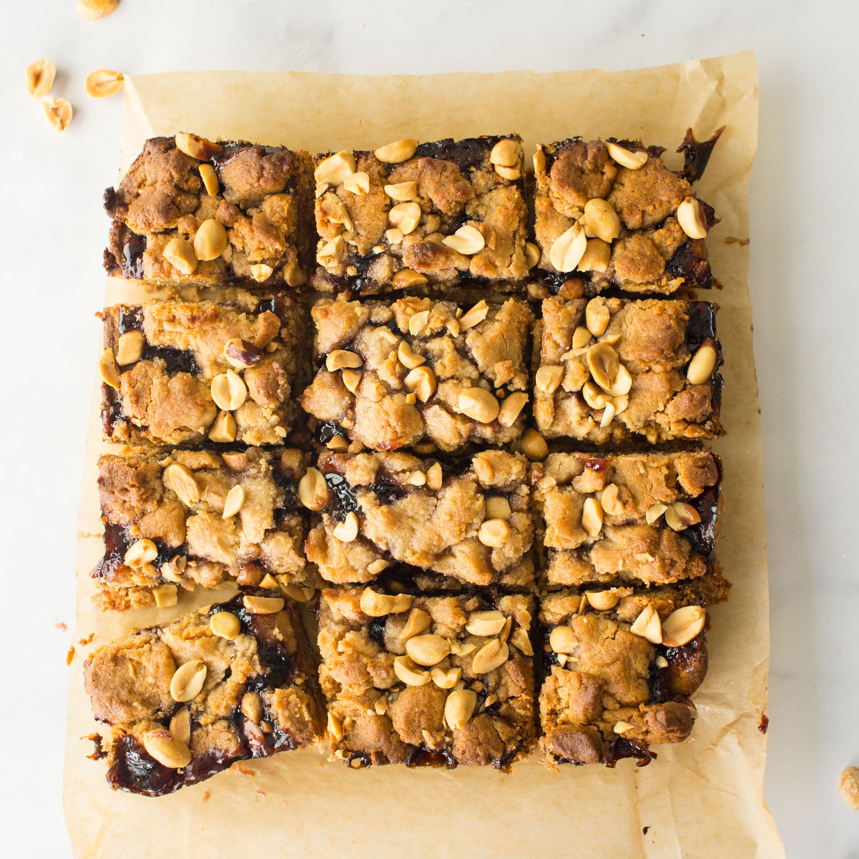 vegan pb and j bars on parchment paper