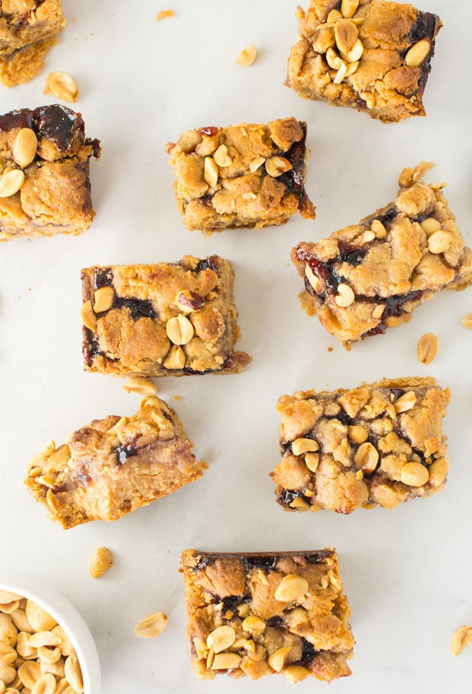 vegan peanut butter and jelly bars on marble background