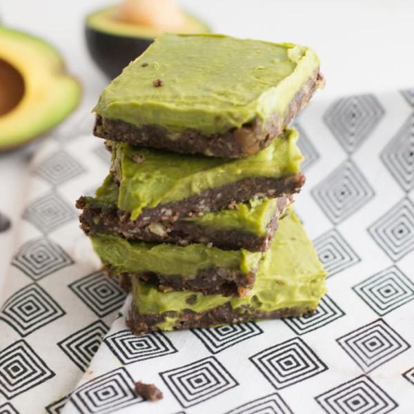 stack of chocolate avocado dessert on white and black napkin