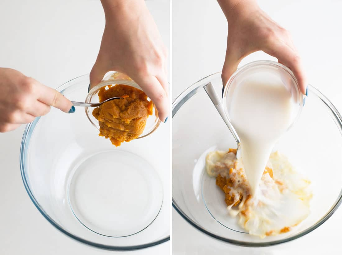 hands mixing pumpkin puree and almond milk in glass mixing bowl