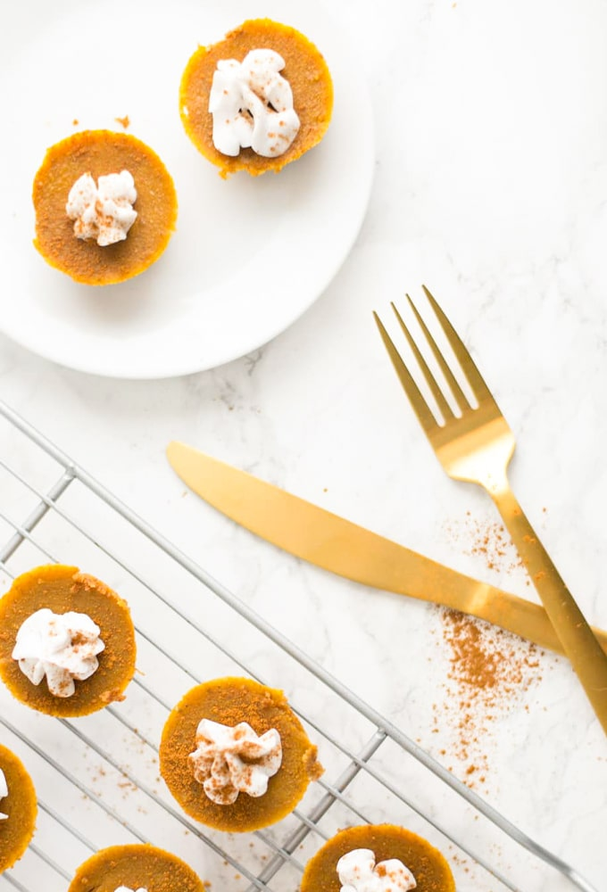 mini pumpkin pie bites on marble counter with gold silverware