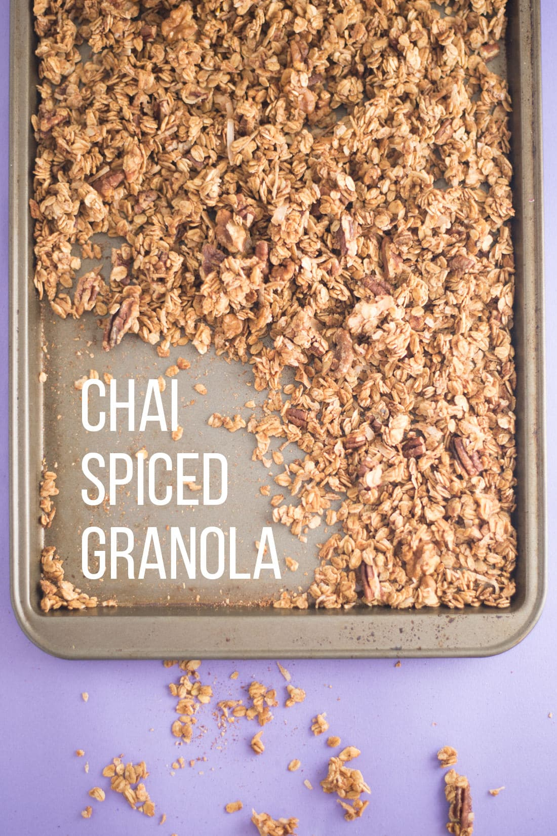 baking sheet full of granola on purple background