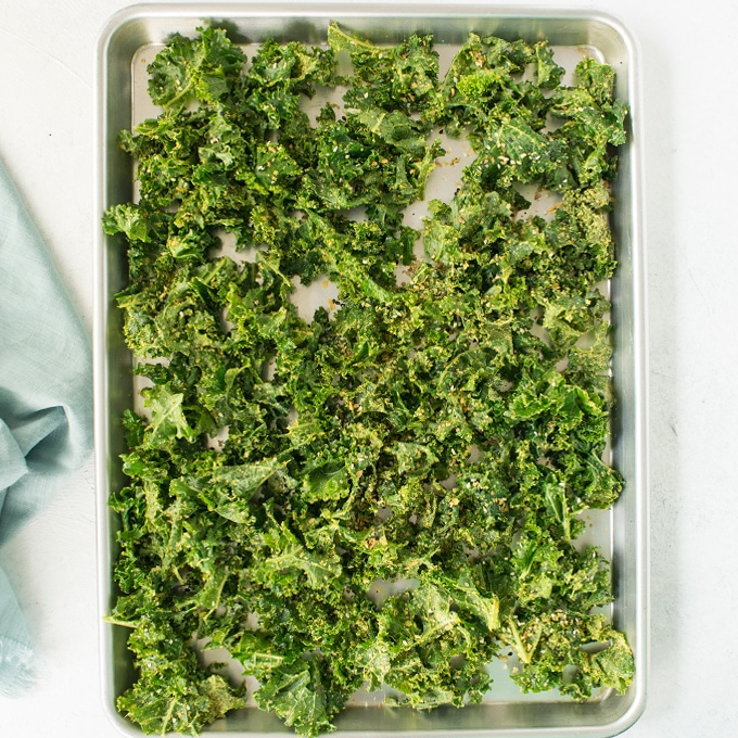 kale on baking sheet for baked kale chips