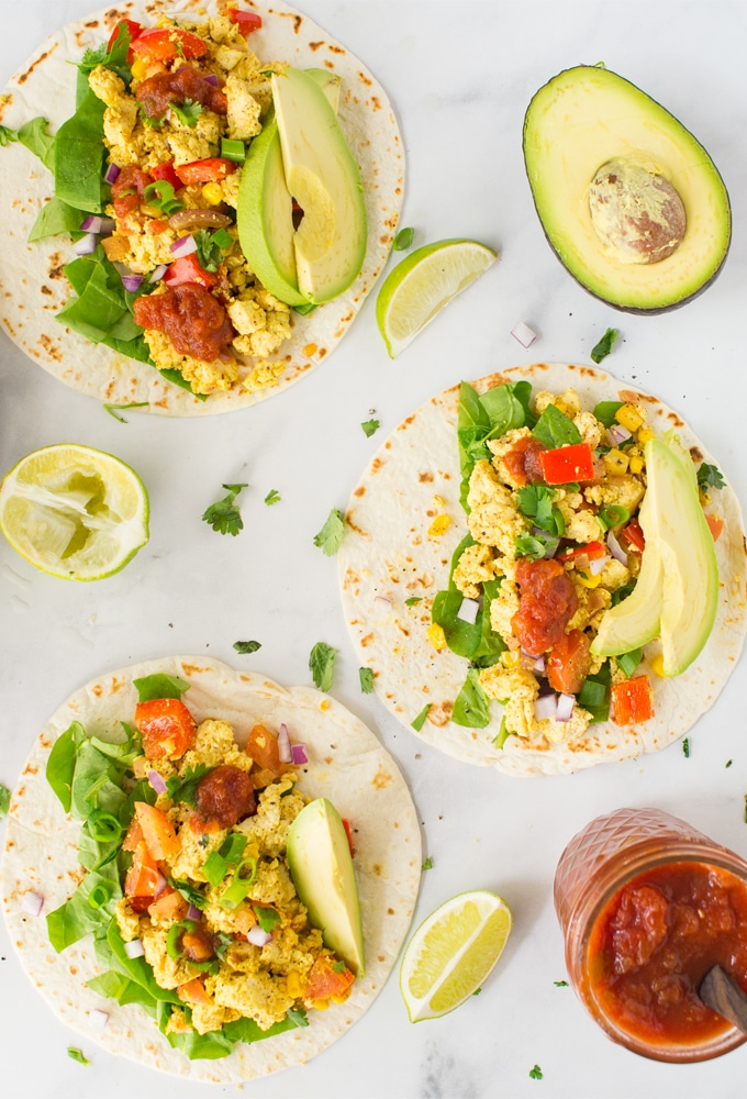 vegan tofu scramble tacos on white background