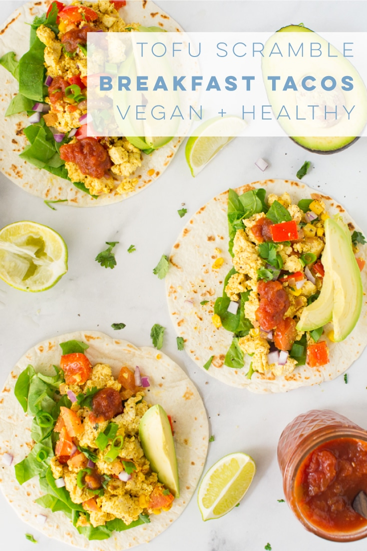 Whip together an easy and delicious tofu scramble for a savory vegan breakfast recipe! Pile with all the toppings like cilantro, avocado, and salsa for some loaded breakfast tacos! #vegan #vegetarian #glutenfree #tacos #healthy #cleaneating #veganbreakfast #tofuscramble | mindfulavocado