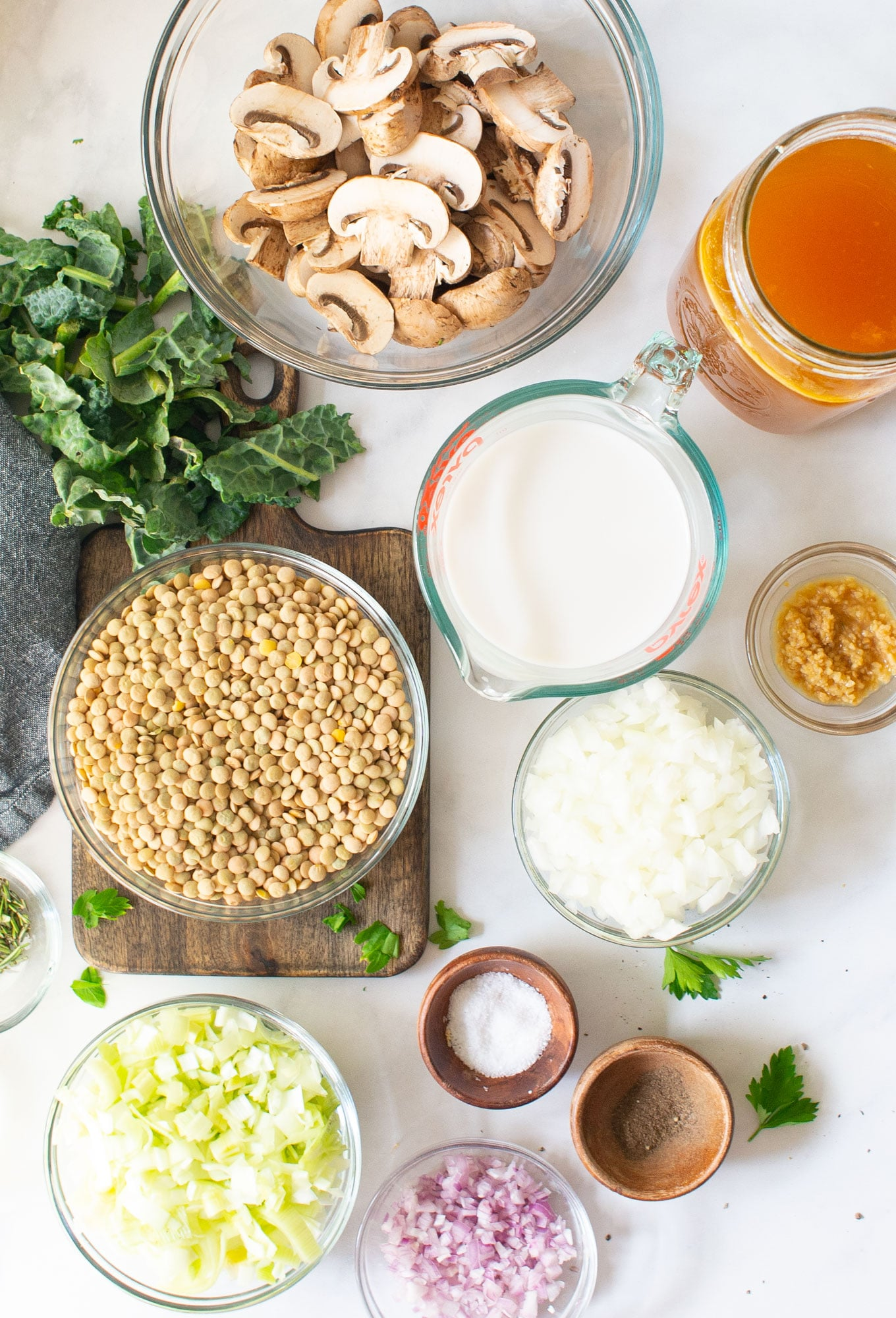 ingredients for lentil leek soup on marble background