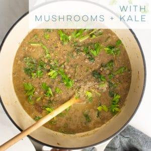 This vegetarian soup is LOADED with healthy ingredients! Lentils, leeks, kale, and mushrooms pair together wonderfully for this easy vegan soup recipe. #soup #vegan #vegetarian #healthy #lentilsoup #mushroomsoup #leeks #weeknightmeal | Mindful Avocado