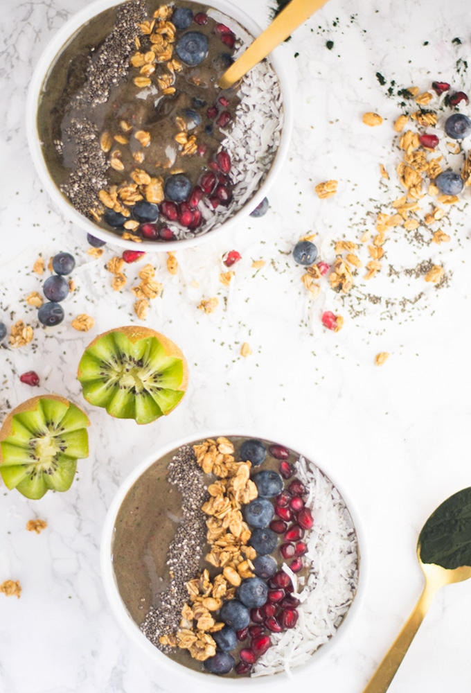 vegan smoothie bowls with fresh fruit, granola, and chia seeds