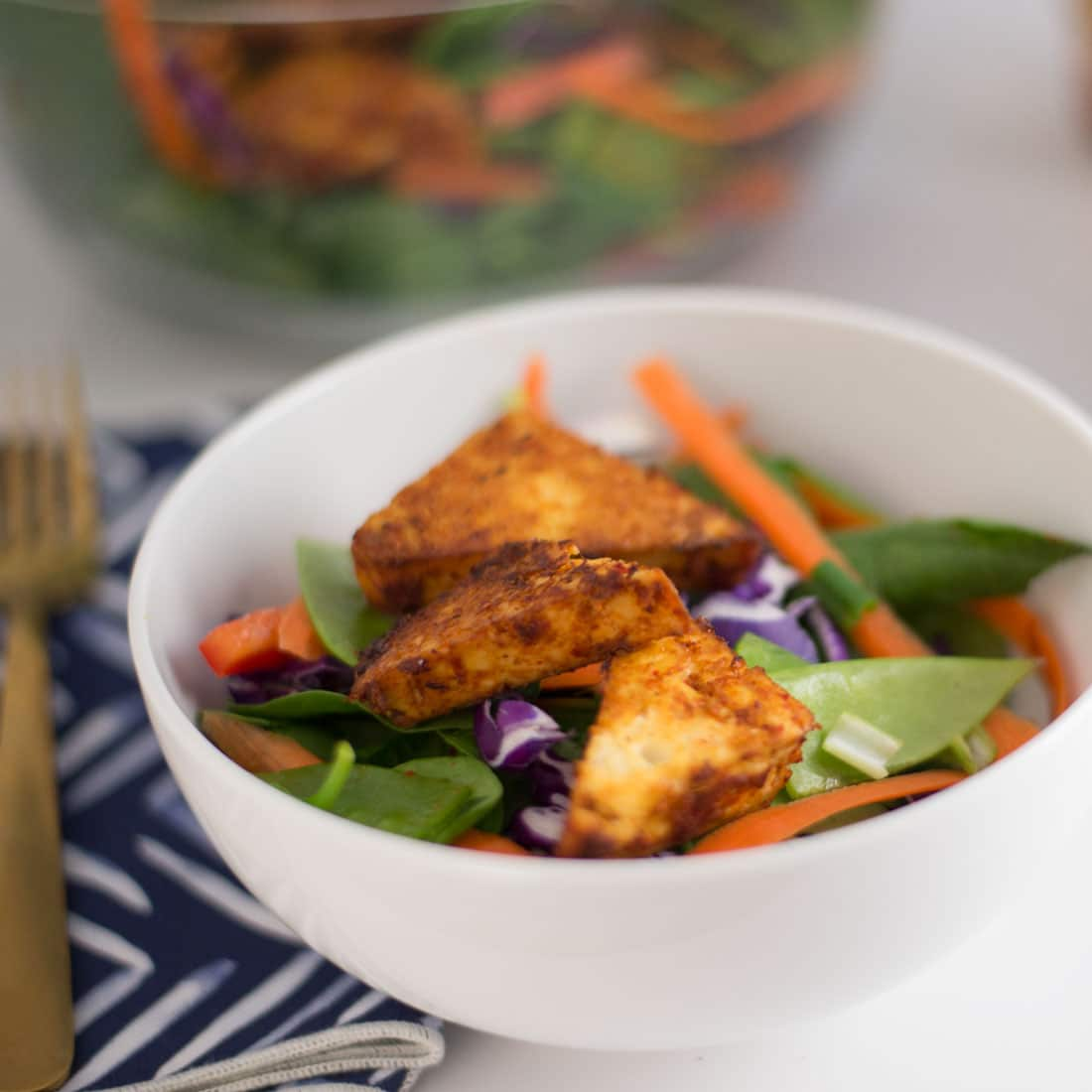 Thai Salad with Red Curry Tofu -- This Thai-inspired tofu has the perfect amount of spice and it so easy to make. Enjoy it with this salad for filling vegan and gluten free meal.   mindfulavocado