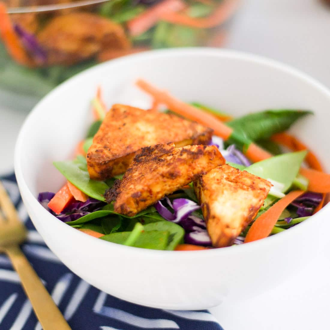 Thai Salad with Red Curry Tofu -- This Thai-inspired tofu has the perfect amount of spice and it so easy to make. Enjoy it with this salad for filling vegan and gluten free meal. | mindfulavocado