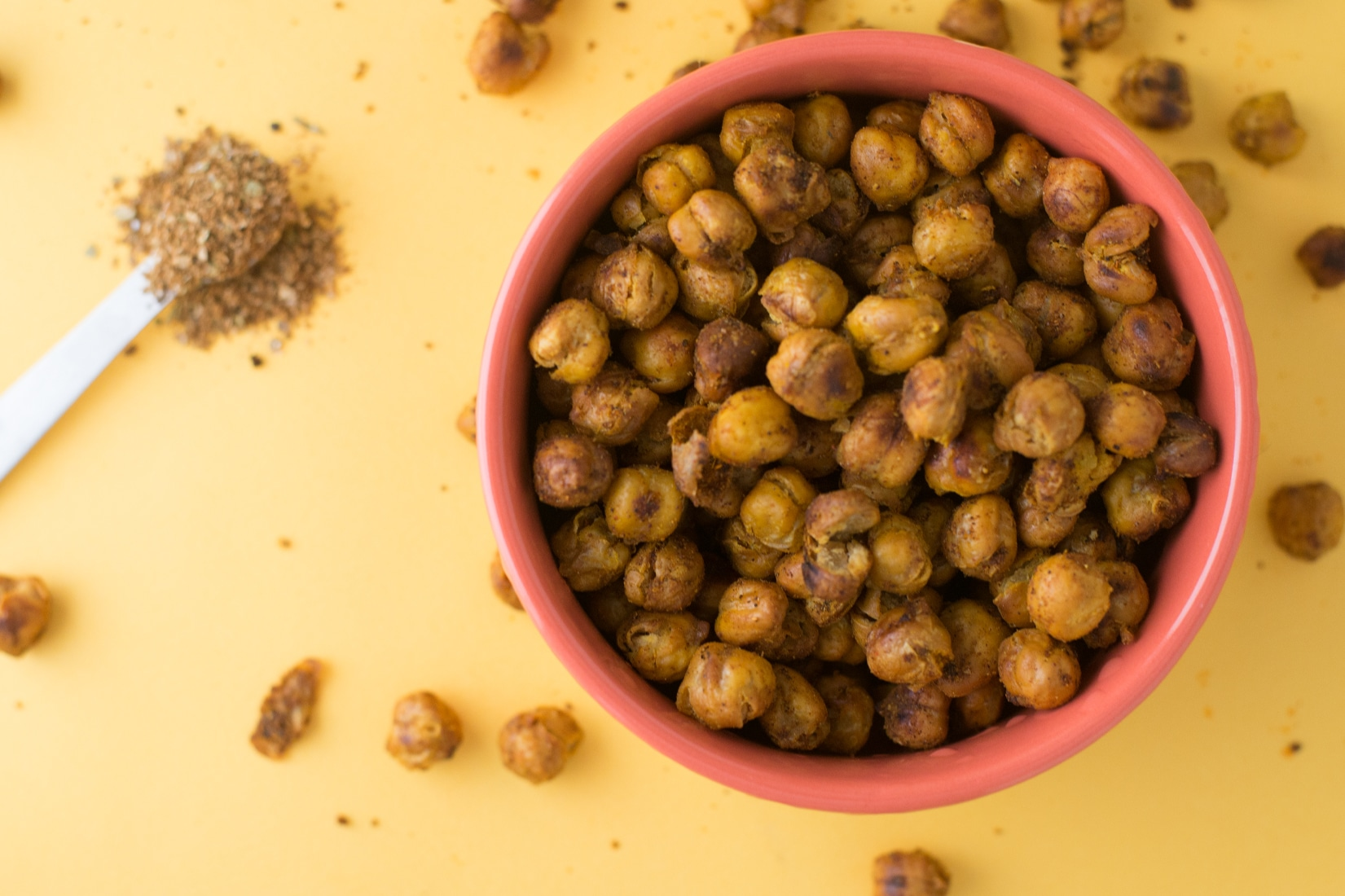 Bowl of roasted chickpeas on yellow background