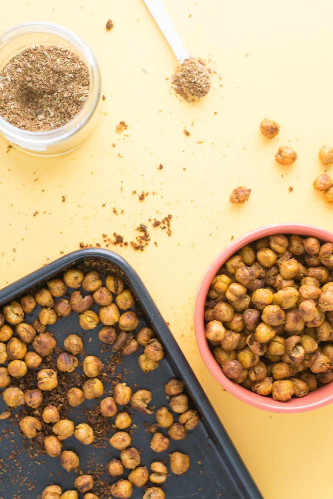 bowl of roasted chickpeas next to baking sheet