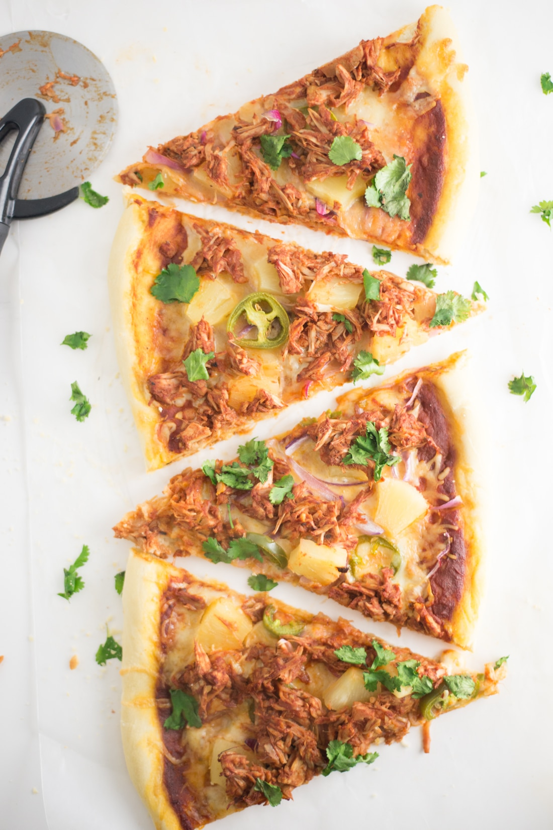 jackfruit pulled pork pizza on white background with pizza cutter