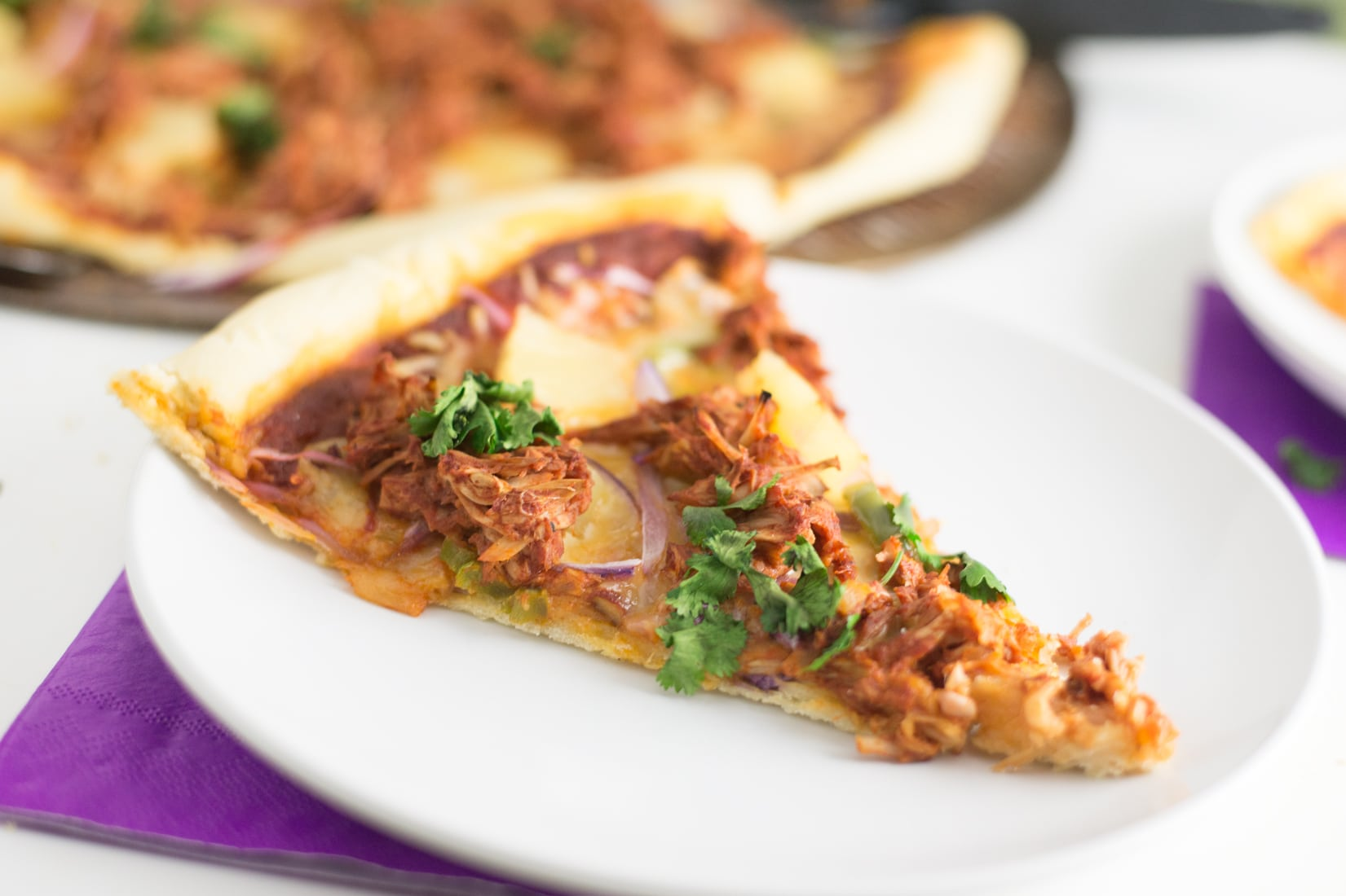 jackfruit pulled pork pizza slice on white plate