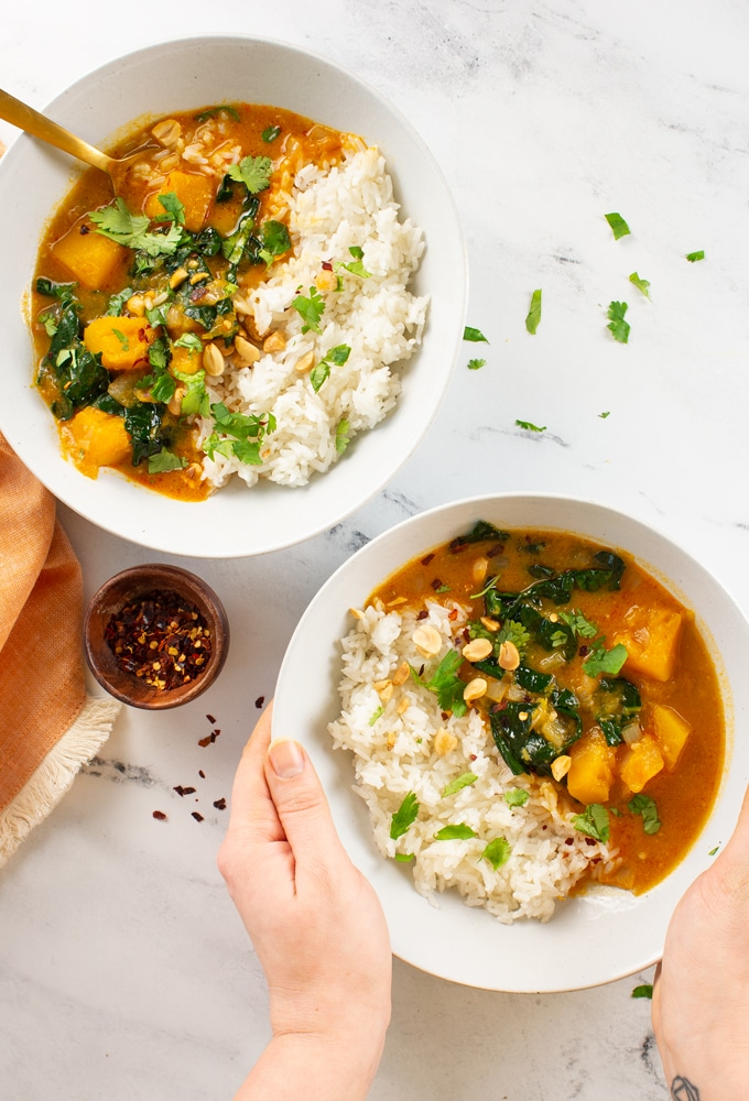 two bowls of vegan curry with rice