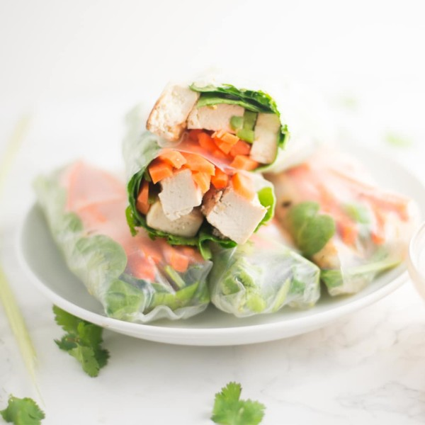 stack of vietnamese spring rolls on white plate