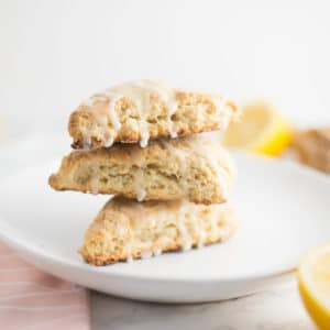 stack of vegan lemon scones on white plate on marble counter