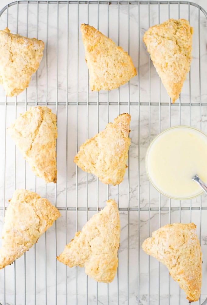 vegan lemon scones on cooling rack with glaze