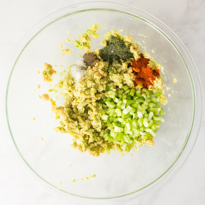 ingredients for chickpea salad sandwich in mixing bowl