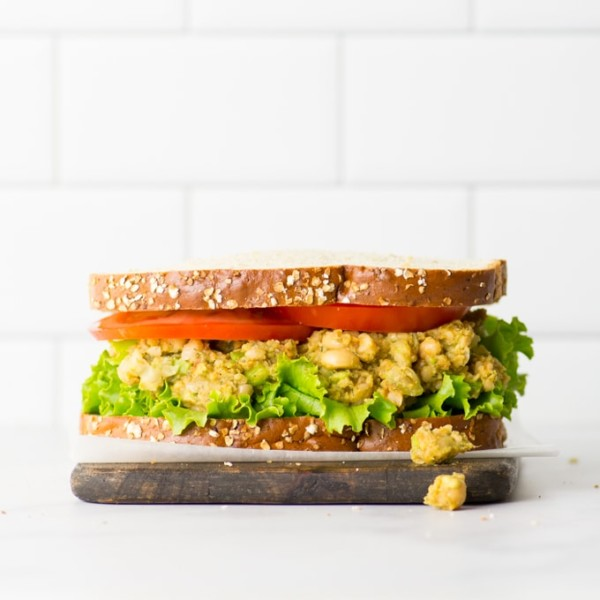 no mayo chickpea salad recipe. vegan sandwich on wood board.
