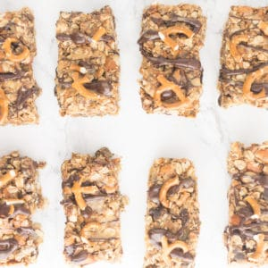 Chocolate Peanut Butter Pretzel Granola Bars -- This granola bar recipe is naturally vegan and gluten free and is packed with healthy ingredients. This takes snacking to a whole new level! - mindfulavocado