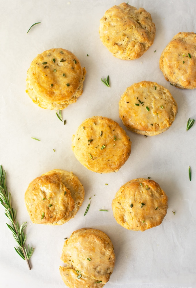 biscuits with fresh rosemary on white background