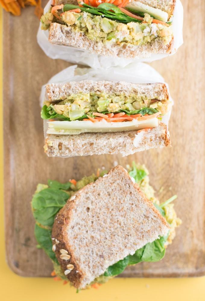 sandwich slices on wooden board