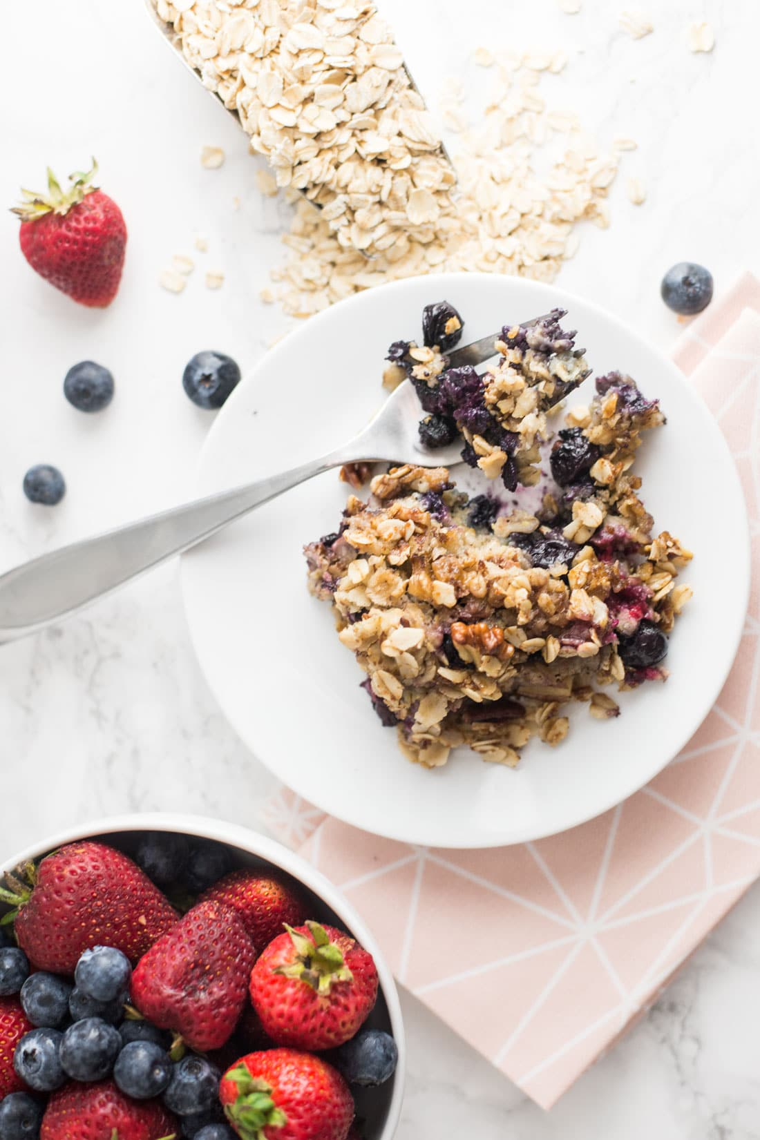 Triple Berry Oatmeal Bake -- This quick and easy vegan breakfast recipe is loaded with fruit and is a healthy way to start your day. - mindfulavocado