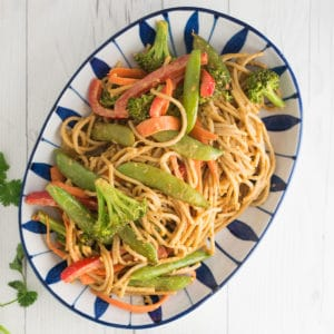 serving dish of peanut noodles with vegetables