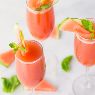 watermelon mint mimosas in champagne flutes