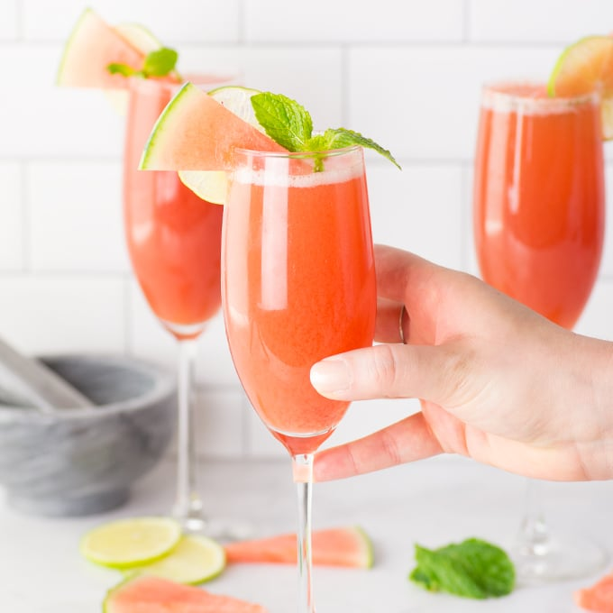 hand holding watermelon mint mimosa
