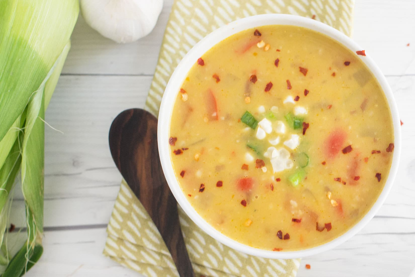 Vegan Corn Chowder -- This creamy corn chowder recipe is not only healthy and easy to make, but perfect for Summer dinners. Fresh corn, red potatoes, and red peppers make this plant based meal so delicious. - mindfulavocado